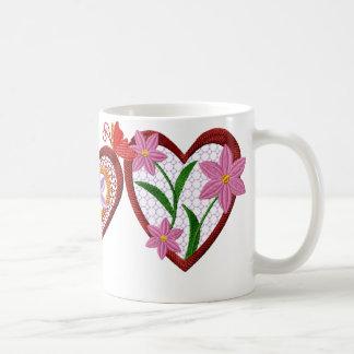 Corazones y taza de las flores
