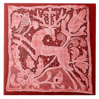 Cordón del navidad en el rojo baldosa cerámica azulejo ceramica