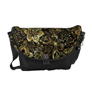Cordón floral retro elegante del oro negro y bolsas de mensajería