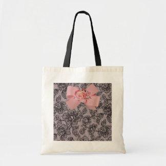 Cordón y rosas negros bolsas de mano