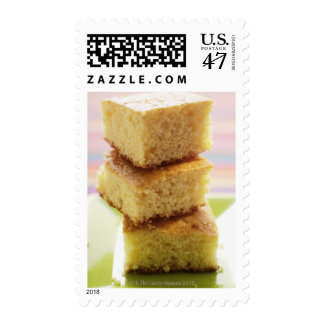 Corn bread, cut into cubes (in a pile) postage stamp
