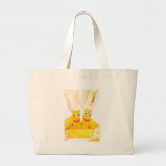 Corncobs with eyes and mouth.jpg large tote bag