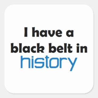 Correa negra de la historia pegatina cuadrada