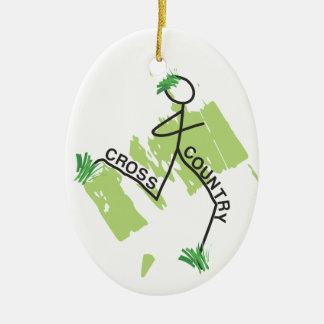 Corredor de la hierba del campo a través adorno navideño ovalado de cerámica