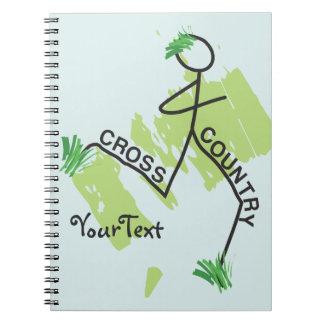Corredor de la hierba del campo a través libro de apuntes