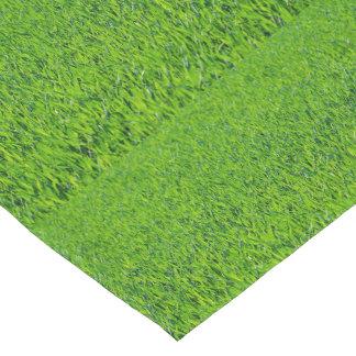 Corredor de la tabla de la hierba verde de la camino de mesa corto