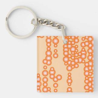 Corriente de burbujas, naranja en colores pastel llavero cuadrado acrílico a doble cara