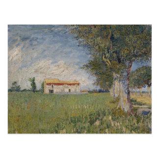 Cortijo en una postal del campo de trigo
