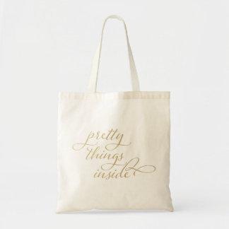 Cosas bonitas dentro bolsa tela barata