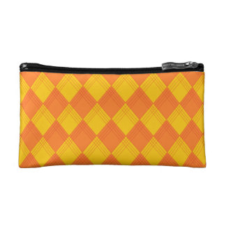 Cosmetics bag with lozenge sample in orange tones