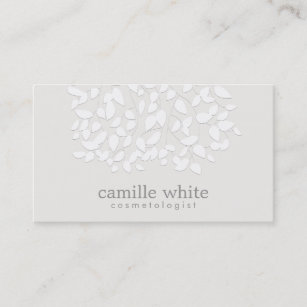 Embossed business cards zazzle cosmetology white embossed look leaves business card colourmoves