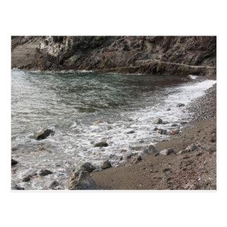 Costa con las piedras y mar en Livorno Postal