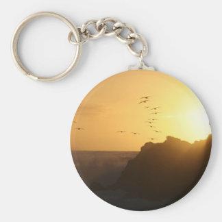 Costa costa de la puesta del sol de los pelícanos  llavero