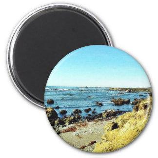 Costa de la playa en el mar del agua del océano de iman de nevera