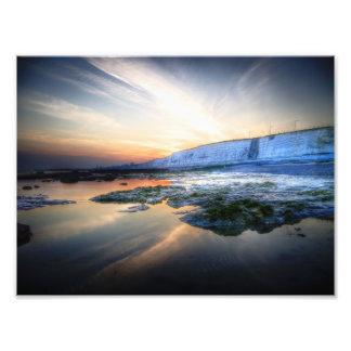 Costa de la puesta del sol arte con fotos