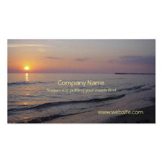 Costa de las ondas de la playa de la puesta del tarjetas de visita