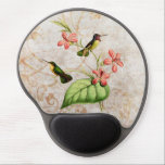 """Costa&#39;s Hummingbird Gel Mouse Pad<br><div class=""""desc"""">Gel mouse pad features a vintage illustration of two Costa&#39;s Hummingbirds (Calypte costae.) Two green and gold hummingbirds perch on a tropical plant with pink flowers,  with a gold and white textured vintage grunge background with floral silhouettes and swirls.</div>"""