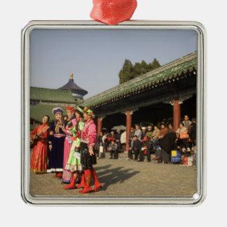 Costumed amateur folk dancers entertain metal ornament