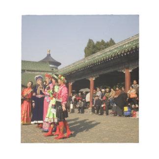 Costumed amateur folk dancers entertain note pad