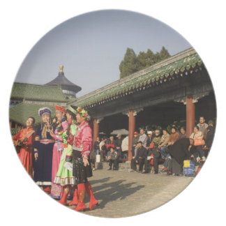 Costumed amateur folk dancers entertain plates