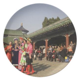 Costumed amateur folk dancers entertain plate