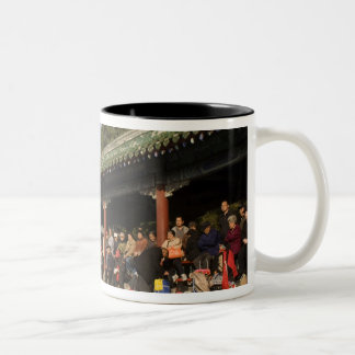 Costumed amateur folk dancers entertain Two-Tone coffee mug