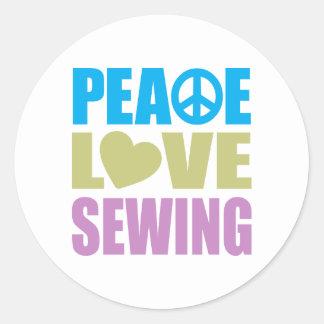 Costura del amor de la paz etiqueta
