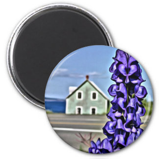 Cosy little house by the sea with a lupine flower magnet