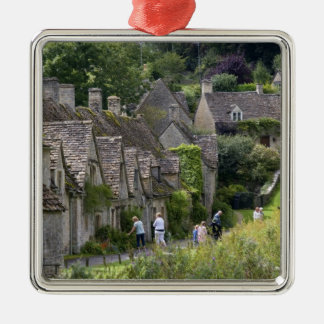 Cotswold stone cottages in the village of metal ornament