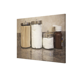Cotton and tongue depressors in doctors office. canvas print