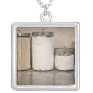 Cotton and tongue depressors in doctors office. silver plated necklace