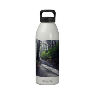 Country road through forest drinking bottles