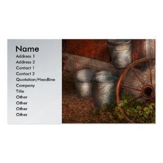 Country - Some dented pails and an old wheel Business Card