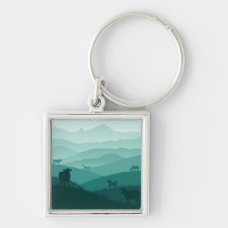Countryside morning fog scenery with animals keychain