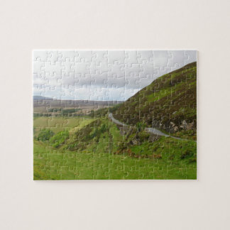 Countryside road bends around hill in Ireland Jigsaw Puzzle