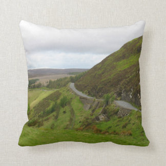 Countryside road bends around hill in Ireland Throw Pillow