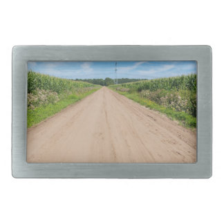 Countryside with sandy road and corn fields belt buckle