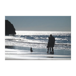 Couple and Their Dog by the Ocean Canvas Print