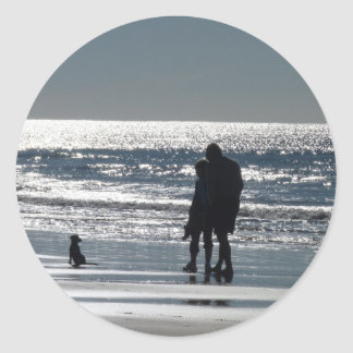 Couple and Their Dog by the Ocean Classic Round Sticker