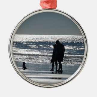 Couple and Their Dog by the Ocean - Personalizable Metal Ornament