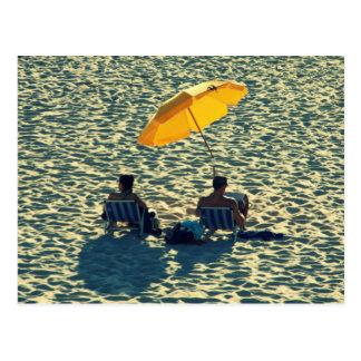 Couple at the beach postcard