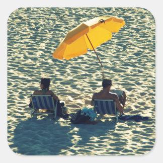 Couple at the beach square sticker