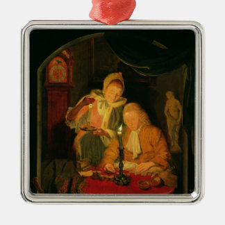 Couple counting money by candlelight, 1779 metal ornament