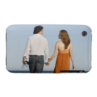 Couple holding hands and walking on beach iPhone 3 case