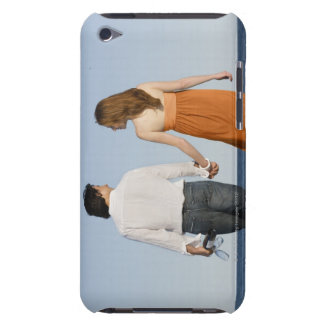 Couple holding hands and walking on beach iPod touch case