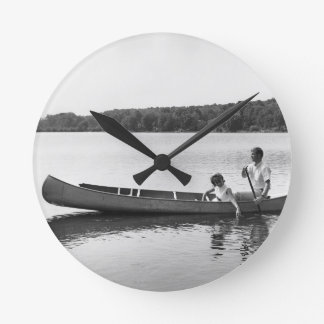 Couple in a Canoe Round Clock