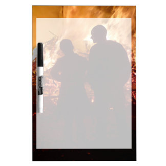 Couple in front of campfire dry erase board