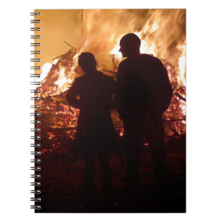 Couple in front of campfire notebook
