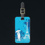 "Couple in Paris with Eiffle Tower Bag Tag<br><div class=""desc"">This modern and eye-catching design is ideal for someone that loves Paris and the Eiffel Tower. It features a loving couple under an umbrella with the Eiffel Tower to the side and a few rain drops. This makes a perfect gift for a couple that just got engaged, got married or...</div>"