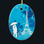 """Couple in Paris with Eiffle Tower Ceramic Ornament<br><div class=""""desc"""">This modern and eye-catching design is ideal for someone that loves Paris and the Eiffel Tower. It features a loving couple under an umbrella with the Eiffel Tower to the side and a few rain drops. This makes a perfect gift for a couple that just got engaged, got married or...</div>"""